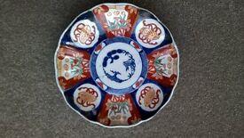 Four antique Imari plates in very good condition.