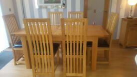 Extended dining table and 6 chairs