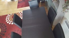 Bjursta black/brown extendable dining table & six leather chairs