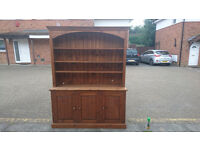 Real wood bookshelf with integrated cupboards and electrical sockets