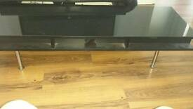 Black high gloss TV table. Not brand new so has signs of wear but still fit for use hence price