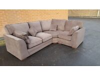 Very nice Brand New brown fabric corner sofa. in the boxes. can deliver