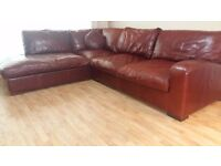 Luxury real leather corner suite in Burgundy . Delivery can be arranged if required.