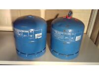 2 off 2.75kg butane gas bottles, one full and one part used.