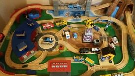 wooden train table with track and extra trains