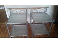 2 bedside glass topped bedside tables. excellent condition