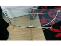 glass and gold coloured metal frame console table