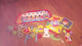 Selection of baby toys including cot toys Vtech and Fisher Price