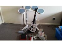 Nintendo Wii with games, drums and guitar