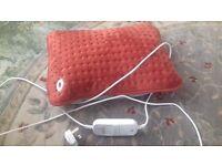 Electric heated cushion.