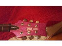 Pink daisy rock guitar