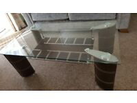 Glass Coffee Table with shelf and brown faux leather legs. Matching dining table 4 faux chairs