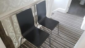 Two ikea chairs black