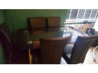 Beautiful glass dining table with six chairs for sale
