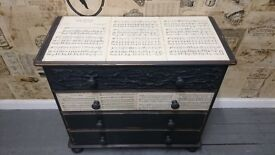Shabby chic/vintage chest of drawers in black with music sheets and original accent on drawers.