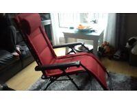 red garden lounger chair