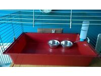 small indoor cage suitable for a guinea pig, inludes water bottle and 2 bowls