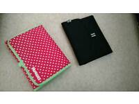 Two travel changing mats