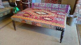 Kilim upholstered coffee table footstool ottoman antique legs upholstered in handmade kilim surrey