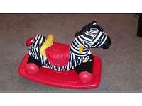 Little tikes zebra ride along and stroller.