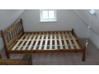 wooden double bed with mattress in good condition