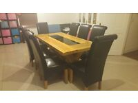 Solid Oak Table with black Glass Panel and 8 matching leather chairs.