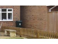 Small garden picket fence with gate
