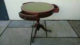 Round leather topped table on wheels