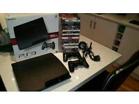 PS3 Slim + 26 games + 2 controllers