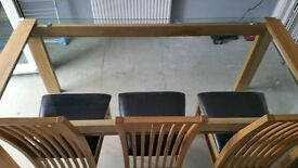 Solid oak glass topped dining table 6 chairs