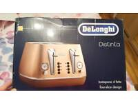 Brand New Delonghi Copper Toaster