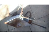 vintage wheelbarrow by iron create with AVON tyre for display or use.