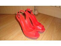 Carvela orange patent shoes