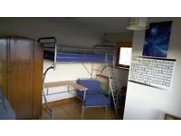 Metal high sleeper with desk and futon/chair