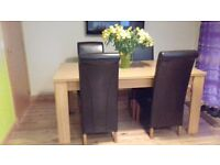Dining table ex Archibalds & 4 brown leather chairs CAN DELIVER