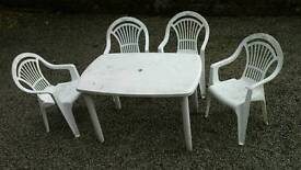Plastic garden furniture, table & four chairs