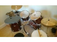 Full Drum Kit, Sticks, Brushes, Sound pads, Instructions and locking key included