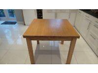 Extending solid oak dining table suitable for dining room or kitchen