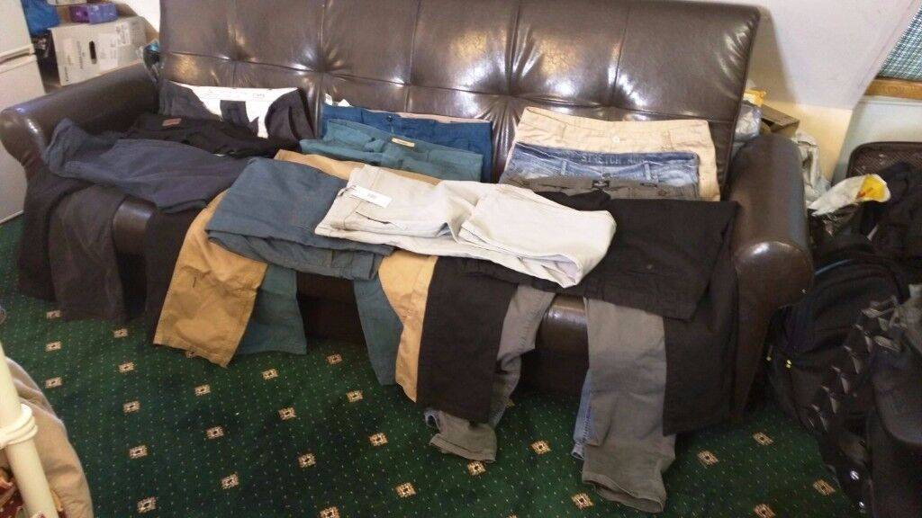 12 Hardly Worn High Quality Chinos and Jeans, some even new.