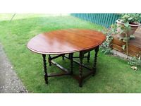 Drop leaf dining table. Oval with turned legs.