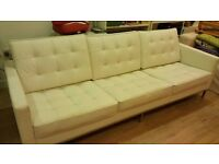 White leather button sofa