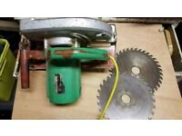 HITACHI SKILL SAW , 9 INCH BLADE, 3 TIPPED BLADES, AND EXTENSION LEAD