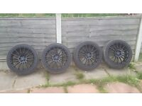 Black 5 stud 18 inch wheels