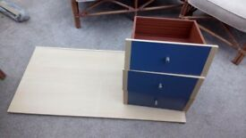 Desk with pull out lap tray, flat packed