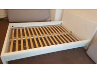 White double Ikea bed frame.