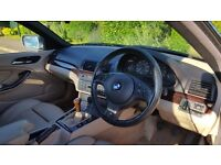 Blue BMW 320 CI M Sport Convertible with hard top and cream leather interior