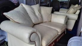 two creme leather sofas good condision i can delivery to anywhere for extra cost