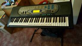 Two large casio keyboards one with stand one without