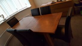 Solid Oak Table and 6 dark Brown/Black chairs- good condition