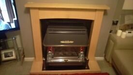 Wooden fire surround, back panel and hearth, granite, oak effect